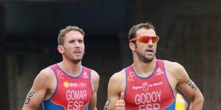 Triathletes running-3 Стоковое Изображение