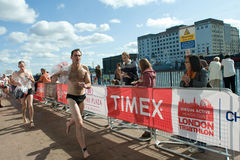 Triathletes starting the run stage of a London triathlon Stock Photos