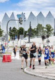Triathletes on the street during first Triathlon Szczecin Race. Royalty Free Stock Image