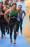 Triathletes sur la zone de passage Photo libre de droits
