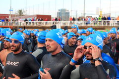Triathletes waiting for the start of the swimming race during Barcelona Garmin Triathlon event Royalty Free Stock Photos