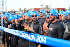 Triathletes waiting for the start of the swimming race during Barcelona Garmin Triathlon event Royalty Free Stock Images