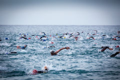 Triathletes in water in the Ironman triathlon competition at Calella beach Stock Images
