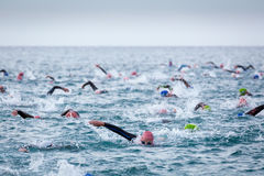 Triathletes in water in the Ironman triathlon competition at Calella beach Royalty Free Stock Photos
