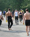 Triathlon athletes. Walking to the start area royalty free stock images