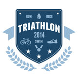 Triathlon badge emblem design. Modern triathlon badge emblem with bike and medal graphics Royalty Free Stock Photos