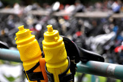 Triathlon bicycle. Water bottles and bicycle during a triathlon Stock Image