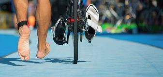 Triathlon bike the transition zone. Detail of the bare feet Stock Images