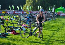 Triathlon competitor  just starting cycling stage of competition. Royalty Free Stock Photos
