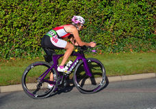 Triathlon competitor on road cycling stage of competition. Royalty Free Stock Photography
