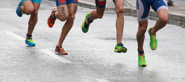 Triathlon feet and legs stock image