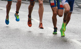 Triathlon feet and legs-2 stock photos