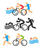 Triathlon icons. Black and colorful Icons symbolizing triathlon, swimming, running and cycling. Vector available Stock Photos