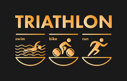Triathlon logo and icon. Gold figures triathlete Royalty Free Stock Image