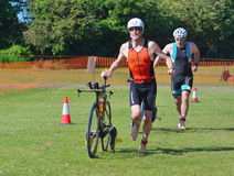 Triathlon Men running in to change over. Royalty Free Stock Images