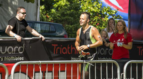 Triathlon runner. Runner sprinting at Hever Castle Triathlon. July 14th 2014 at Hever Castle, Kent, England stock image