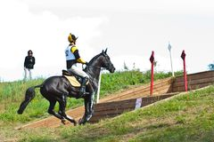 Triathlon in Russia, horseback jumping Royalty Free Stock Photos