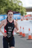 Triathlon sport healthy exercise running. Triathlete Lucy Hall of Team GB running during the elite women`s race at London Triathlon in Docklands in 2016 Royalty Free Stock Photo