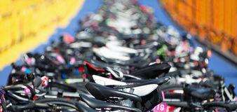 Triathlon the transition zone. Bicycles at triathlon change over station Stock Photo