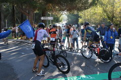 Triathlon triathlete sport healthy exercise bike. Triathletes prepare to mount their bikes at the start of the cycling leg of Challenge Peguera, a half distance Royalty Free Stock Photos