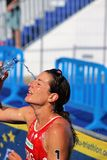 Triathlon triathlete sport healthy exercise celebrate. Switzerland triathlete Nicola Spirig pours water over her face and head at the end of a testing European Royalty Free Stock Photos