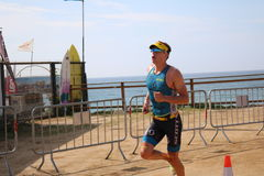 Triathlon triathlete sport healthy exercise run running. A triathlete running at Ironman 70.3 Barcelona Royalty Free Stock Photos