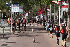 Triathlon triathlete sport healthy exercise running. Triathletes run through the centre of town at Challenge Peguera, a half distance ironman race, in Majorca in Stock Photography