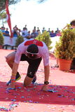 Triathlon triathlete sport healthy exercise shattered. Team GB elite triathlete David Bishop collapses at the finish line at Challenge Peguera, a half distance Stock Photo