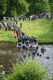 Triathlon triathlete sport healthy exercise swimming. Triathletes enter the water reading for the swimming leg of the Peak District Triathlon in Derbyshire Royalty Free Stock Images