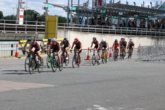 Triathlon triathletes sport healthy exercise cycling. Elite triathletes cycling past London Docklands DLR station during the London Triathlon in 2016 Royalty Free Stock Image