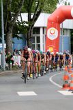 Triathlon triathletes sport healthy exercise cycling. A line of female triathletes cycling in the European Triathlon Sprint Championships Stock Images