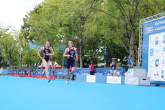 Triathlon triathletes sport healthy exercise run. Team GB triathletes Jess Learmonth and Lucy Hall lead the way out of transition for the run after the bike leg Royalty Free Stock Image