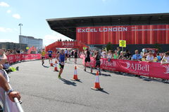 Triathlon triathletes sport healthy exercise running. Triathletes during a running section of the London Triathlon in Docklands Stock Image