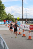 Triathlon triathletes sport healthy exercise running. Team GB elite women triathletes Jess Learmonth and Lucy Hall during the running leg at the 2016 London Royalty Free Stock Photo