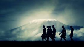 Tribal African Men Walking close to Mount Kilimanjaro