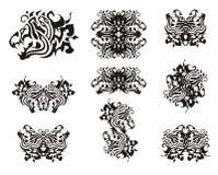 Tribal aggressive dragon head symbols Royalty Free Stock Images