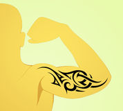 Tribal arm tattoo Stock Photo