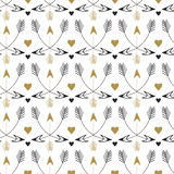 Tribal arrows seamless pattern. Vector print design in ethnic style. Vintage gold and black pattern Royalty Free Stock Photo