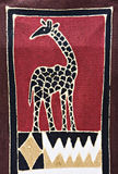 Tribal  art. Tribal craft, giraffe and traditional african motifs painted on rugged textile Royalty Free Stock Photos