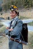 Tribal Attire With Sword. A Nishi tribesman wearing the traditional head-dress having a Great Hornbill beak Stock Photography
