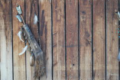 Tribal background of the bow and feathers Royalty Free Stock Image