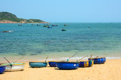 Tribal boats on beautiful beach Royalty Free Stock Image