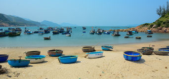 Tribal boats on beautiful beach Royalty Free Stock Photos