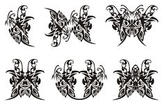 Tribal butterfly symbols. Black on the white Royalty Free Stock Photography