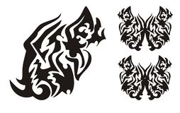 Tribal butterfly wing in the dragon head form and butterflies tattoo Stock Photos
