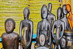 Tribal carved wooden figures for sale in a souvenir shop royalty free stock image