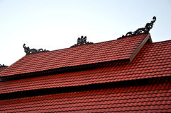 Tribal carvings on the roof top of buildings Stock Photo