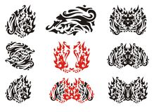 Tribal cat leaf and butterflies from it. Flaming aggressive cat stylized in the form of a leaf in red-black tones and tribal butterflies from it Stock Photography