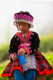 Tribal children Akha girl with traditional clothes and silver jewelery Royalty Free Stock Images