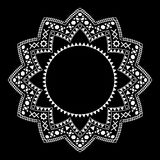 Tribal circle ornament on the black background. Stock Photography